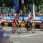 BMC with George, Tejay and Cadel toting a little one on his leg down the Champs-Élysées.